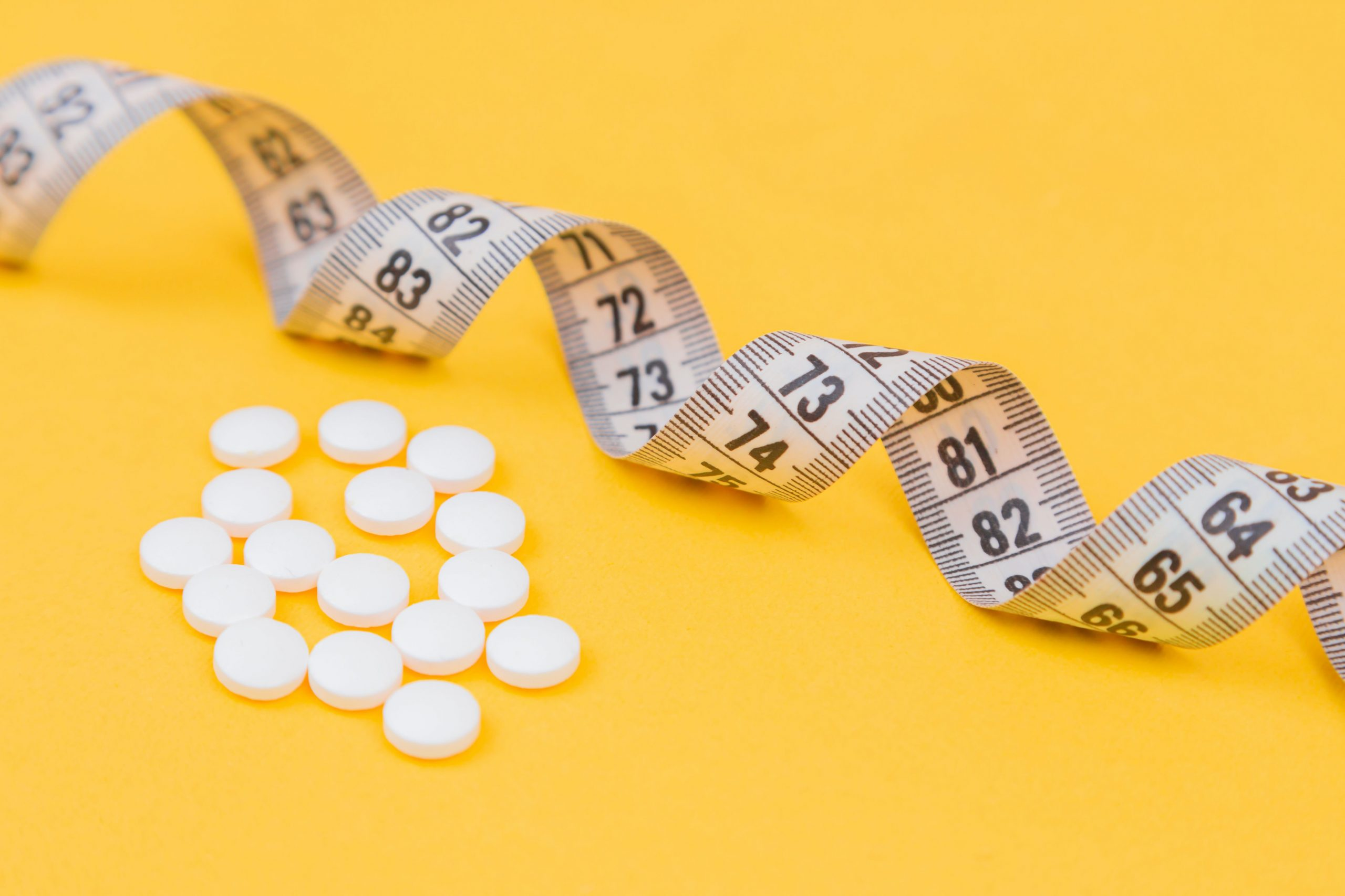 Medications and measuring tape photo by Diana Polekhina on Unsplash